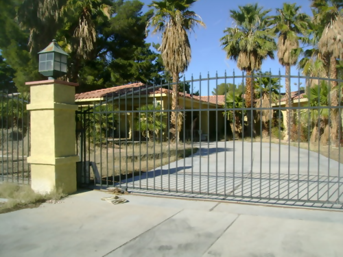 gate in front of la palazza mansion