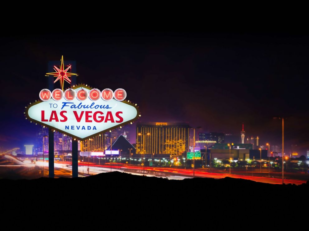 photo shows las vegas, lit up with lights at night time
