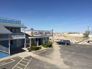 a view of the clown motel with the tonopah cemetery right behind it