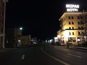 photo shows the Mizpah Hotel at night with its sign lit up