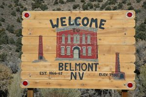 photo shows a hand painted sign welcoming visitors to Belmont