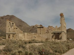photo shows a crumbling building in rhyolite ghost town